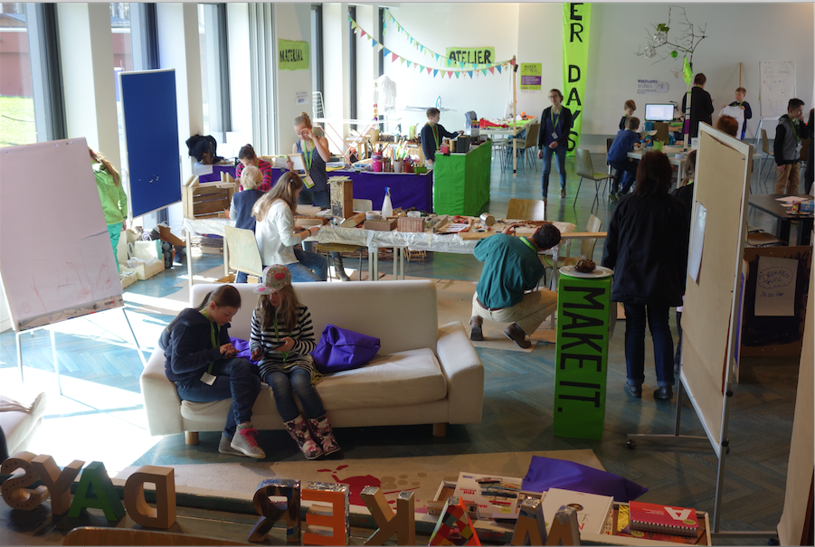 Participants engaged in creative design projects during the 'Maker Days for Kids Workshop'